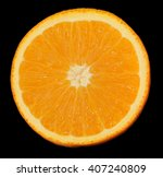 Sliced Orange On A Black...