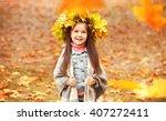 happy young girl in yellow... | Shutterstock . vector #407272411