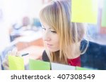 attractive blonde woman writing ... | Shutterstock . vector #407308549