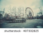 Small photo of Abandoned carousel and abandoned ferris at an amusement park in the center of the city of Pripyat, the Chernobyl disaster, the exclusion zone, a ghost town