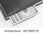 dollars in diary | Shutterstock . vector #407385175