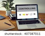 controlling laptop on table.... | Shutterstock . vector #407387011