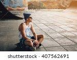 man on skateboard.listen music... | Shutterstock . vector #407562691
