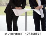 two businessmen looking at... | Shutterstock . vector #407568514