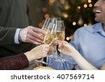 a family celebrating christmas... | Shutterstock . vector #407569714