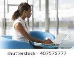 a businesswoman sitting at a... | Shutterstock . vector #407572777