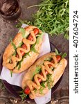 grilled hot dog with mustard. | Shutterstock . vector #407604724