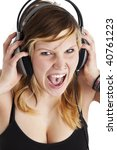 young woman screams for joy while listening to music - stock photo
