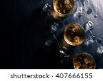 glasses of whiskey with ice... | Shutterstock . vector #407666155