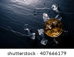 glass of whiskey with ice cubes ... | Shutterstock . vector #407666179
