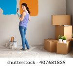 happy smiling woman painting... | Shutterstock . vector #407681839