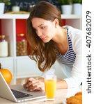 young woman sitting near desk... | Shutterstock . vector #407682079