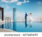 bride and groom near the... | Shutterstock . vector #407689699