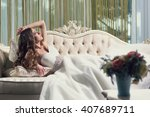 beautiful bride lying on the... | Shutterstock . vector #407689711