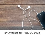 white earphones and mobile... | Shutterstock . vector #407701435