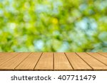 empty top wooden table and... | Shutterstock . vector #407711479
