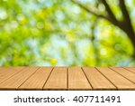 empty top wooden table and... | Shutterstock . vector #407711491