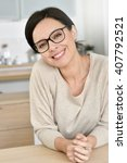 Small photo of Attractive 40-year-old woman with eyeglasses