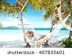 Woman Relaxing In The Hammock...