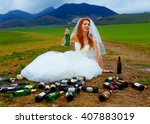Small photo of drunken bride with lots of empty beer bottles in mountain landscape - funny wedding concept