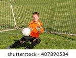 boy goalkeeper defends the goal   Shutterstock . vector #407890534
