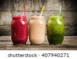 three milkshakes and smoothies... | Shutterstock . vector #407940271