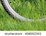 bike wheel on green grass meadow | Shutterstock . vector #408002341