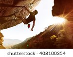 freeclimber at sunset | Shutterstock . vector #408100354