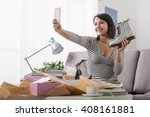 smiling woman unboxing a postal ... | Shutterstock . vector #408161881