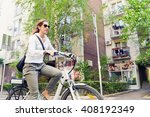 E Bike Commuter  Riding Throug...