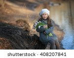 pretty girl in a gray coat ... | Shutterstock . vector #408207841