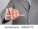 Man holding a pencil to close a business deal - stock photo