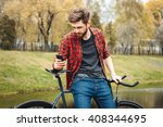 handsome young man in red shirt ... | Shutterstock . vector #408344695