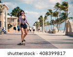 sporty young woman riding long... | Shutterstock . vector #408399817