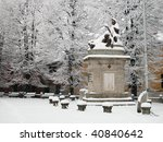 Snow covered statue in a winter day - stock photo