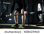 lifting barbell in gym | Shutterstock . vector #408425965