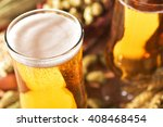 two beer glasses with hops ...   Shutterstock . vector #408468454