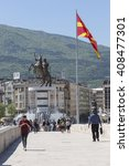Small photo of SKOPJE, MACEDONIA - APRIL 14, 2016: Square Makedonia, the capital's main square, with people passing by and Alexander the Great statue