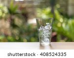 glass of water and ice on soft... | Shutterstock . vector #408524335