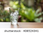 glass of water and ice on soft... | Shutterstock . vector #408524341