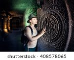 Tourist Woman In Green Hat...