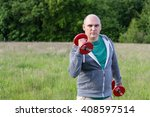 man working outdoors with 5kg... | Shutterstock . vector #408597514