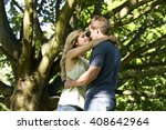 a young couple standing beneath ... | Shutterstock . vector #408642964