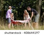 a family laying a picnic... | Shutterstock . vector #408644197