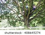 a young boy and girl climbing a ... | Shutterstock . vector #408645274