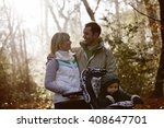 a young couple pushing a... | Shutterstock . vector #408647701