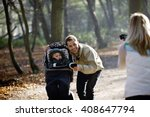 a mother photographing her... | Shutterstock . vector #408647794