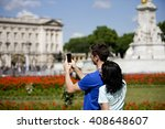 a young couple taking a picture ... | Shutterstock . vector #408648607