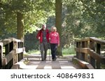 a mature couple walking over a... | Shutterstock . vector #408649831