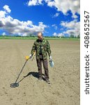Man With Metal Detector....
